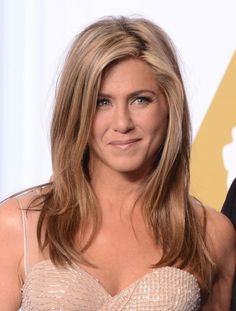 """Jennifer Aniston's hair is just as famous as she is — maybe even more so. Sure, the actress was amazing as Rachel on Friends, but it was """"The Rachel"""" that people still talk about today. Now, with a new innovative product, the Night Cap Overnight Perfector (which she calls """"incredible"""" and """"wonderful"""" because it penetrates the hair follicle and you don't have to wash it out), to add to the already revolutionary line, Aniston talks with Yahoo Style about chemistry, business, and, of course…"""