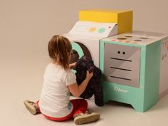 Playing house in retro style wih Eco and You's recyclable cardboard play kitchen appliances