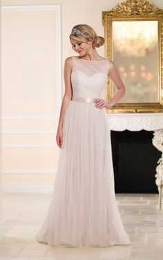 6091 This vintage-inspired Tulle sheath gown from the Stella York wedding dress collection features a whimsical illusion neckline over a sweetheart bodice, and a figure-flattering Satin waist sash. The playful skirt falls elegantly to the floor into an elegant court train. The back zips up under fabric-covered buttons. Choose from ivory champagne beading or white silver beading.