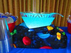 Outer space themed party, baby shower.  Glowing blue punch.  punch bowl set on a light box