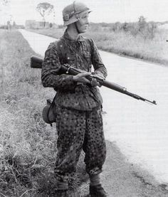 "A young Grenadier of the 12th SS-Panzer-Division ""Hitlerjugend"" somewhere in Normandy/France, July 1944. In the years 1943/44 the average age of the Waffen-SS trooper was 18/19 years."