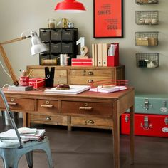Industrial home office:    Laminate flooring with a concrete effect gives this home office a functional look. Wood and metal are livened up with touches of bold colour.