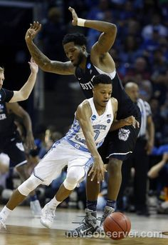 North Carolina's Nate Britt (0) drives around Butler's Tyler Wideman (4) during the second half of UNC's 92-80 victory over Butler in the NCAA Tournament South Regional semifinal at FedExForum in Memphis, TN Friday, March 24, 2017.