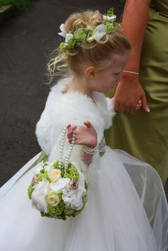Adorable head piece and bouquet for a flower girl.