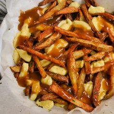 This popular Canadian Poutine is a delicious dish made with crispy fries, melted cheese curds, and beefy gravy. The end result is pure magic and one everyone should try. I like to make it on a big baking sheet or in a big ovenproof bowl so I can warm the cheese curds right before I ladle on the gravy. Poutine is a hearty side so it does not need a lot to accompany it to make it a full meal. I like to serve it with something light like Marinated Cucumbers and Red Onions or Vinegar Coleslaw.