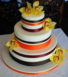 3 tiered round Carrot Cake with a Cream Cheese Buttercream filling and yellow orchids.