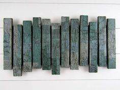 Houten wanden, Pleinen and Wandsculpturen on Pinterest