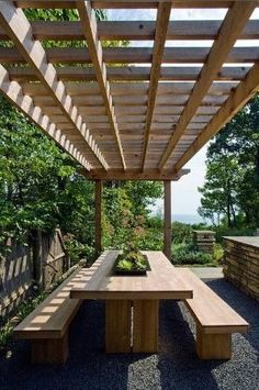 pergola covered outdoor dining area
