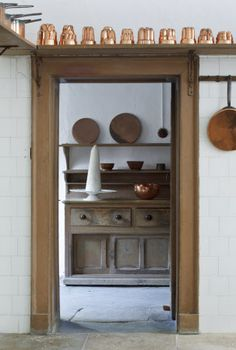 View into the Pastry Room from the Great Kitchen at Saltram, Devon.