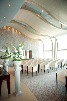 Wedding chapel onboard Allure of the Seas. Soft neutrals and an ocean backdrop.