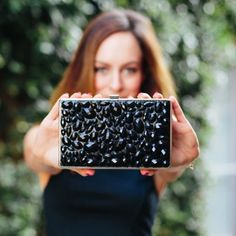 Black beaded box evening clutch with silver chain A great evening clutch staple. The front has black beaded embellishment. The back is solid black. Has a silver chain you can use to wear the clutch over the shoulder or as a crossbody too. Marciano Bags Clutches & Wristlets