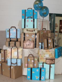 Vintage looking suitcases made from boxes, ribbon, and printed travel stamps