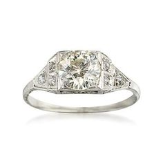 I have a ring exactly like this from Tiffany's. It was my great aunts and is to die for. I do feel bad keeping these things in safety deposit boxes.