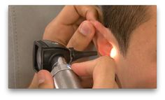 A demonstration of how to conduct an ear, nose and throat examination.