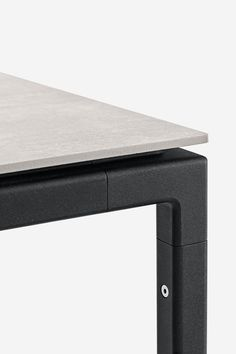 The Vipp table is a medium-sized table for the dining room or kitchen. The table features a steel frame with soft rounded corners that carries a highly durable, stoneware tabletop. | Vipp.com