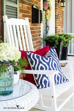 Patriotic Porch Decor Ideas | On Sutton Place I love the white rocking chairs and the white table.  The add the pops of colors with pillows.