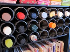 DIY:  French Drain Organization -  this is the most brilliant tip I've ever found on Pinterest!  This blogger bought a 10' piece of French Drain (it's a black, plastic bendable tube, with slits in it) at Home Depot, cut the tube into sections & slid the sections into a shelf.  Those sections keep all of her supplies (craft supplies, paint, etc.) organized. This would be great in the garage - to store screws, nails, fasteners, etc.