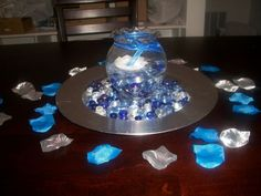 blue and silver wedding centerpieces- danyelle, you can rent the glass bowls like this from Nora (the ones I had at my wedding) and glass beads are easy to get (she may have some blue and clear ones from my wedding also).  Renting would be cheaper than buying.