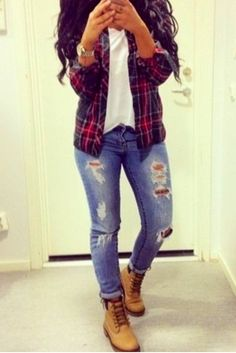Love the plaid over shirt, basic white tee, ripped skinnies and Timberland booties.