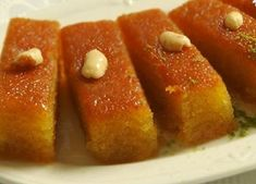 Revani- (a Turkish soft, much sweet pastry which is made by semolina) Iftar, Sweets Recipes, No Bake Desserts, Middle Eastern Sweets, Arabian Food, Sweet Corner, Arabic Sweets, Sweet Pastries, Party Food And Drinks
