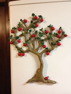 "This apple tree refrigerator magnet is 12"" H with each apple having its own magnet formed into the back so they can be placed anywhere on the tree. As with my other magnets, this is made from Sculpey clay."