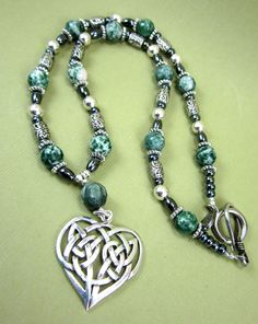 Sterling silver Celtic heart with tree agates, hematite and Tibetan silver spacers.