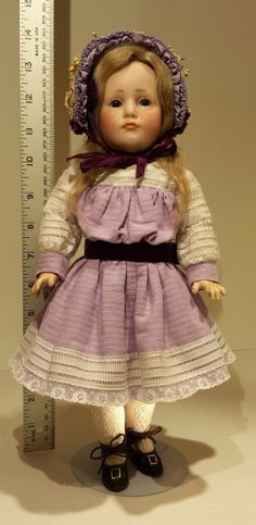 """13 inch 1916 Kammer & Reinhardt 114 Gretchen with Glass Sleep Eyes & Great Condition. Very few of this model of doll were made with glass sleep eyes. I looked up """"1916 girls costumes"""" and this style was on an April 1916 magazine cover. I couldn't believe it!"""