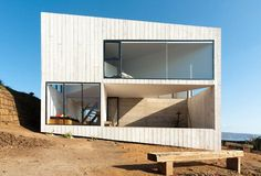 This house in Matanzas , Chile by  Panorama, is situated at the top of a cliff, 65 mts. approximately above sea level.  A two storey house, for a couple and their son, is structured within a square volume of 9 by 9mts. Inside intersects another...
