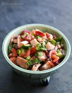 Octopus Salad (Ensalada de Pulpo) ~ Mexican style octopus salad, with tomatoes, green and red onion, cucumbers, and cilantro. ~ SimplyRecipes.com