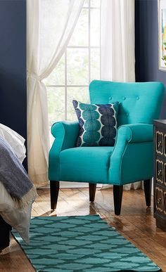 Showcasing rolled arms and tapered wood legs, this charming tufted arm chair brings a pop of style to your living room or library. Add a pop of color to a room at http://jossandmain.com