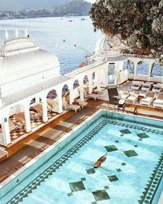 Taj Lake Palace Udaipur India. The Taj Lake Palace in Udaipur might really be the most romantic hotel in the world. This luxurious and stylish 5-star property is set literally in the middle of Lake Pichola. Built in 1746 its majestic unique architecture makes it one of the most recognisable residences in the world! /tajhotels/ @tajlakepalace   Photo by @emelinaah #welovehotels #awesomehotel #beautifulhotels #tajhotels #tajhotelsandresorts #udaipur #india #romantichotel #travelindia #tajla...
