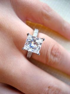 Custom-designed, princess-cut engagement ring, with pave band and a pretty nice rock!