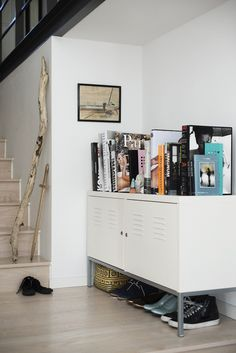 """Sneak Peek: Camilla Ebdrup and Andreas Stenmann: """"In the hallway by the staircase, there was just enough room for the IKEA furniture that holds our collection of photography books."""""""