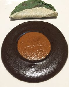 1244 Day Old Mole Madre and Mole Nuevo. The fifth course on the menu at Pujol in Mexico City. Read the review on our site!  Pujol 2.0 Mexico City Distrito Federal D.F. Restaurant Review World's 50 Best Latin America's 50 Best Restaurants Chef Enrique Olvera Fine Dining Lunch Tasting Menu Mexican Food Foodie Gastronomy