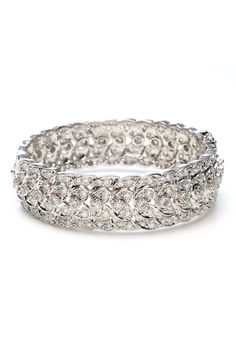 Tejani. Style Classic Openable Bracelet - B166. Classically designed bangle styled with a floral pattern and accents of round-cut cubic zirconia. Set in brass wwith rhodium plating (shown in silver finish).