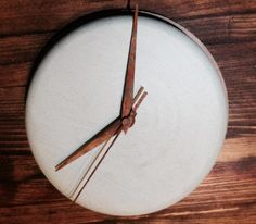 concrete clock with rust effect hands