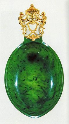 """Fabergé Jade Kosch, an oval, boat shaped, 25cm long ceremonial drinking cup with golden handle with diamonds and a """"NII"""" monogram. This was a gift of the Tsar Nicolas II to Ambassador Boutiron, the French ambassador to Russia in 1906, Musée des Arts Décoratifs, Paris, France."""