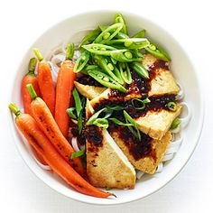 Tofu and Rice Noodles with Black Bean Sauce   This easy, healthy weeknight dinner perfectly combines crunchy vegetables, meaty pan-seared tofu, and chewy rice noodles.