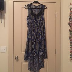 Fun print low-high dress Black blue and white print dress. Hi (hits top of knees) in front and longer know back. Mesh insert around top. Elastic waist and thick straps. Forever 21 Dresses Midi