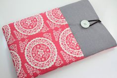 I like the contrast of the gray with the pink, but the string doesn't look very sturdy. - MacBook Air 11 inch Case Laptop Sleeve Cover Padded  by PinkOasis, $26.90
