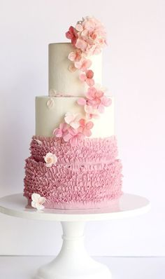 Breathtaking half white half pink textured wedding cake accented with pretty pink flowers