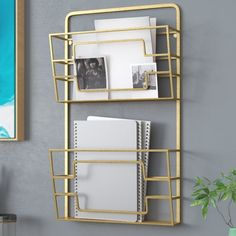 This Magazine Rack features a metal rectangular frame in gold finish, D-shaped wall hang, slanted front panel. Rack Design, Magazine Rack Wall, Bookcase Organization, Decor, Guest Bedroom Design, Magazine Holders, Remodel Bedroom, Shabby Chic Homes, Blanket Rack