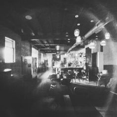 The bustling interior of The Brew & Brew. Interesting to see how empty it looks when it was really quite happening.  Asking everyone to hold still for an hour and a half isn't really a thing 😄Exposure took about 1.5 hrs at EV 5-7.  On Ilford Harman direct positive paper. #buttomat  #pinhole #pinholecamera #photography #blackandwhite  #experiment #ilford #harman #darkroom #madeinaustintx #techshop #atx #austin