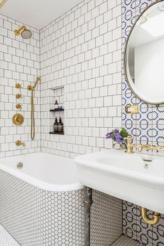 Brass Fixtures in a Tiled Bathroom