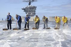 PACIFIC OCEAN (April 1, 2013) Sailors scrub the flight deck aboard the USS Nimitz (CVN 68). The aircraft carrier recently left its homeport of Everett, Wash., for a sustainment training exercise in preparation for an upcoming deployment. (U.S. Navy photo by Mass Communication Specialist 3rd Class George J. Penney III)