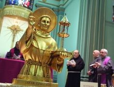 A gold reliquary containing a piece of skin from St. Anthony of Padua is the centerpiece of a prayer service at St. Francis Friary.