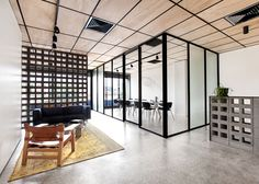 Clare Cousins designs shared offices with colour-coordinated details