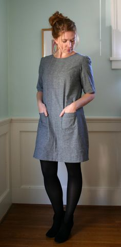 """Pattern: Laurel by Colette Patterns Fabric: gray cotton chambray Mods: exposed zipper Sizing: This pattern has a lot of room. According to my measurements, I cut a size 8 for the bust, graded to a size 10 for the rest of the dress, then wound up removing 3"""" of fabric when I installed the zipper. Looks like I could have just done a straight size 8 and it still may have been big. I can actually get it off and on without using the zipper."""