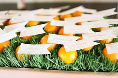 Citrus escort card idea from Skybox Event Productions