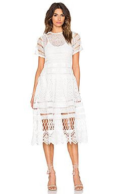 Shop for Alexis Alanna Midi Dress in White at REVOLVE. Free 2-3 day shipping and returns, 30 day price match guarantee.